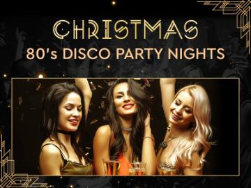 Christmas Party nights for 80's Disco party nights, with 3 ladies dressed up in christmas dress and champagne