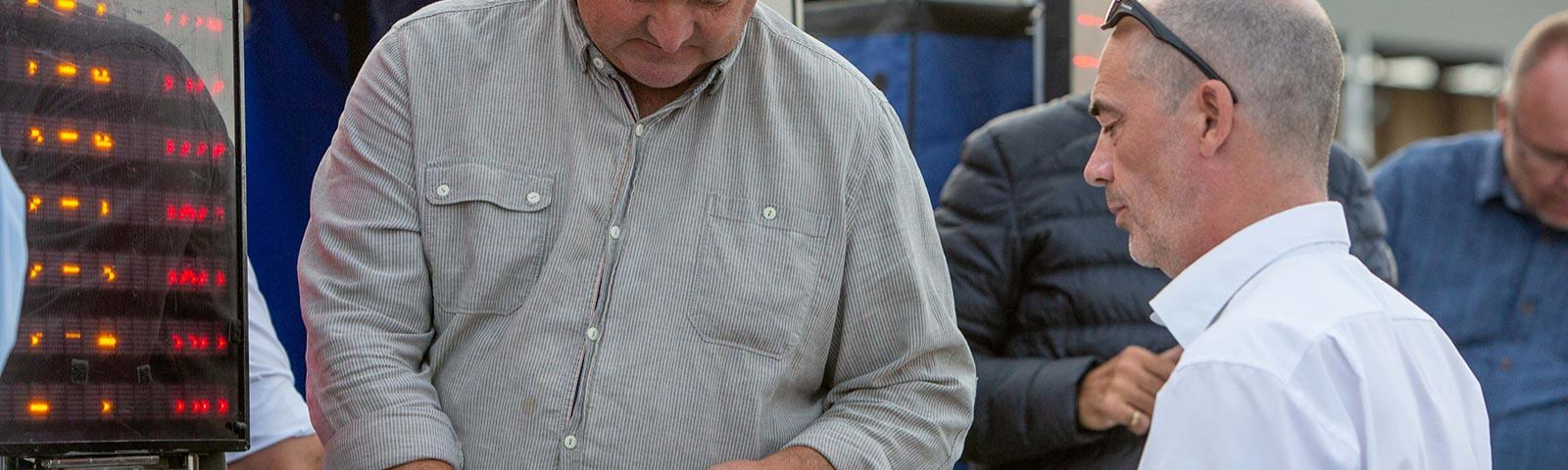 Racegoer placing a bet with a bookmaker.