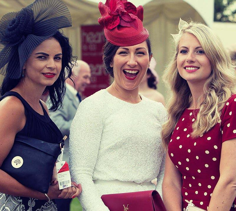3 Ladies smiling for the camera at Great Yarmouth Racecourse.
