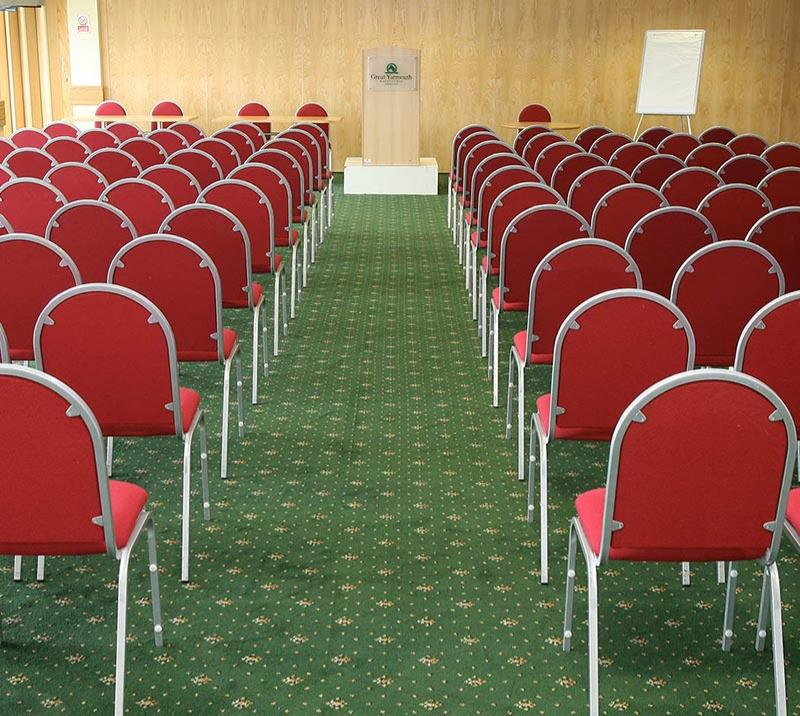 A selection of chairs laid out ready for a speaker